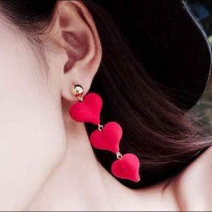 Dangling red heart earrings